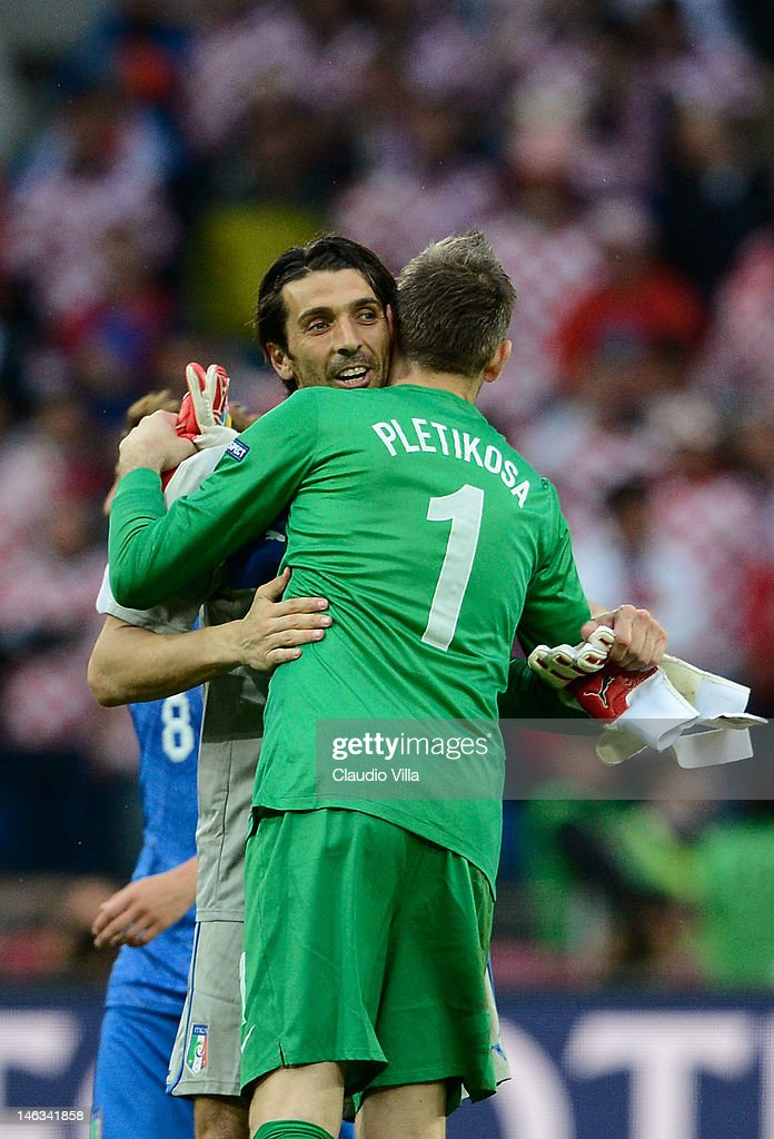 Gianluigi Buffon of Italy hugs his opposite number Stipe Pletikosa of Croatia during the UEFA EURO 2012 group C match between Italy and Croatia at...