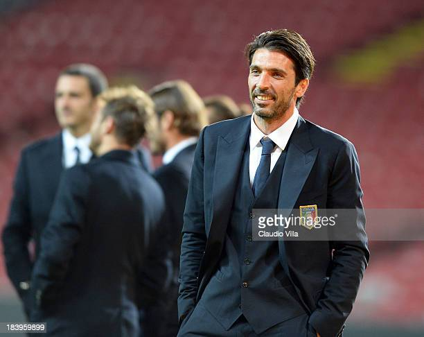 Gianluigi Buffon of Italy inspects the pitch ahead of tomorrow's FIFA 2014 World Cup group B Qualifier against Denmark at Parken Stadium on October...