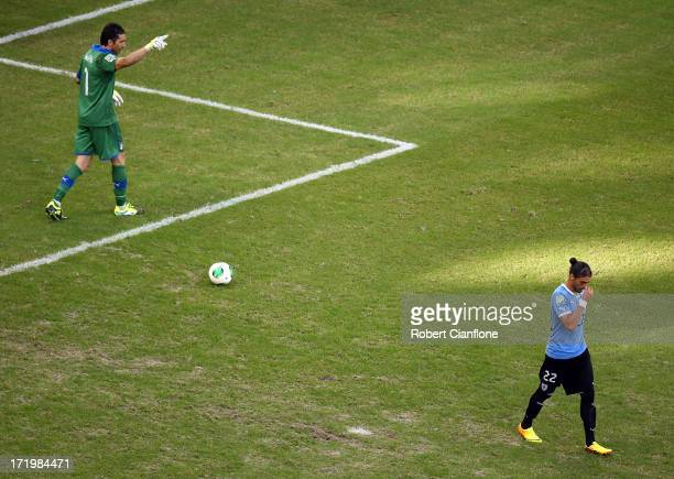Gianluigi Buffon of Italy reacts after saving the penalty of Martin Caceres of Uruguay during a shootout during the FIFA Confederations Cup Brazil...