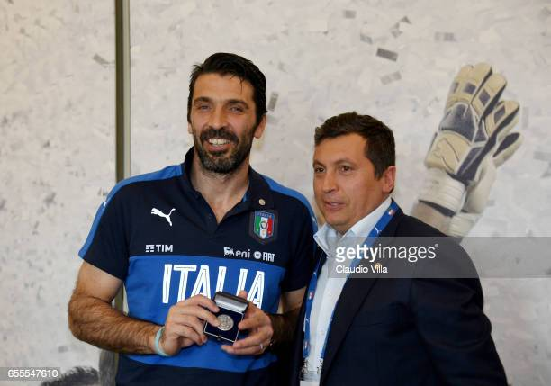 Gianluigi Buffon of Italy receives an award prior to the training session at the club's training ground at Coverciano on March 20 2017 in Florence...