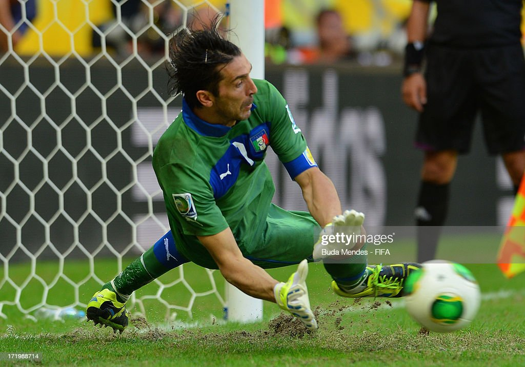 Gianluigi Buffon of Italy saves the penalty of Walter Gargano of Uruguay to clinch victory in a shootout during the FIFA Confederations Cup Brazil...
