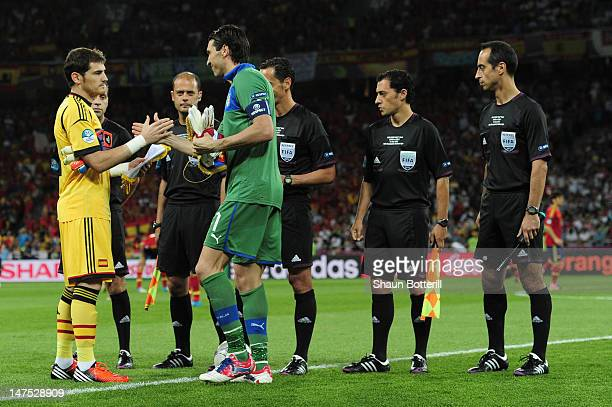 Gianluigi Buffon of Italy shakes hands with Iker Casillas of Spain next to the match officials before the UEFA EURO 2012 final match between Spain...