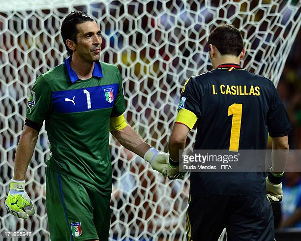 Gianluigi Buffon of Italy touches gloves with Iker Casillas of Spain during a penalty shootout during the FIFA Confederations Cup Brazil 2013 Semi...