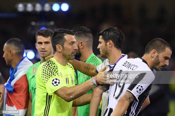 Gianluigi Buffon of Juventus and Alvaro Morata of Real Madrid embrace after the UEFA Champions League Final between Juventus and Real Madrid at...