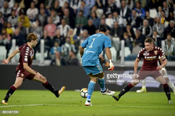 Gianluigi Buffon of Juventus and Andrea Belotti of Torino competes for the ball during the Serie A match between Juventus and Torino FC on September...
