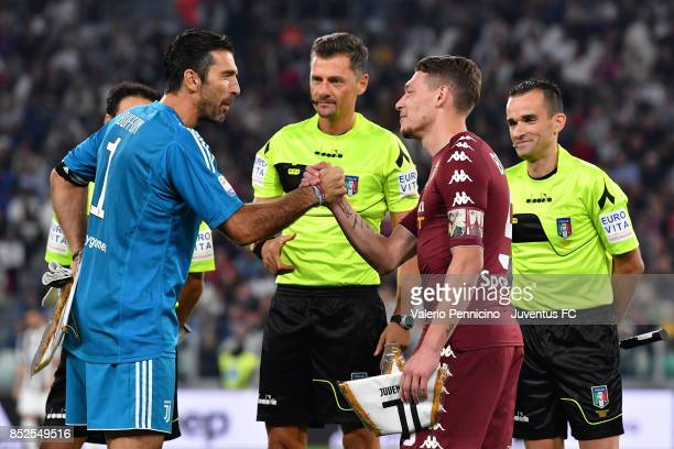 Gianluigi Buffon of Juventus and Andrea Belotti of Torino during the Serie A match between Juventus and Torino FC on September 23 2017 in Turin Italy