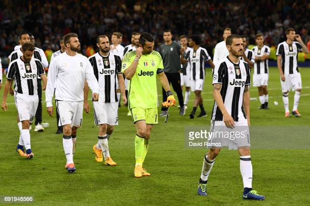 Gianluigi Buffon of Juventus and his team walk off dejected after the UEFA Champions League Final between Juventus and Real Madrid at National...