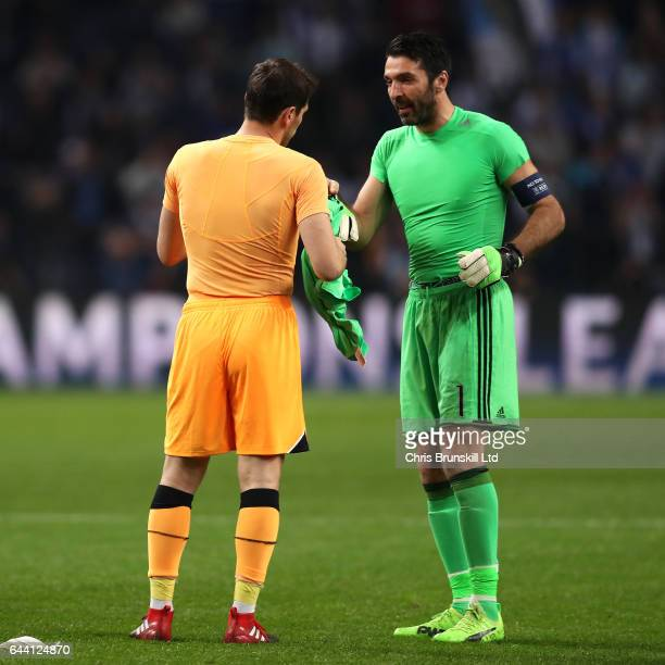 Gianluigi Buffon of Juventus and Iker Casillas of FC Porto exchange shirts at the end of the UEFA Champions League Round of 16 first leg match...