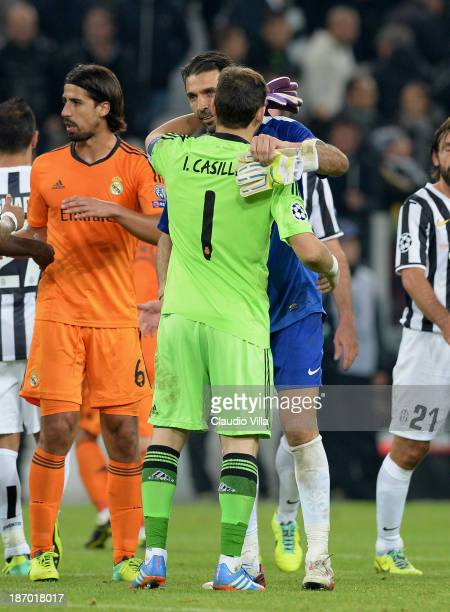 Gianluigi Buffon of Juventus and Iker Casillas of Real Madrid after the UEFA Champions League Group B match between Juventus and Real Madrid at...