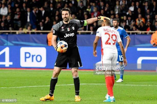 Gianluigi Buffon of Juventus and Kylian Mbappe of Monaco during the Uefa Champions League match semi final first leg between As Monaco and Juventus...