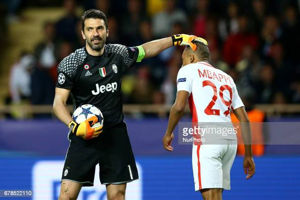 Gianluigi Buffon of Juventus and Kylian Mbappe of Monaco during the UEFA Champions League Semi Final first leg match between AS Monaco v Juventus at...