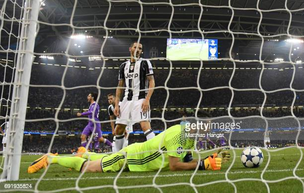 Gianluigi Buffon of Juventus and Leonardo Bonucci of Juventus react during the UEFA Champions League Final between Juventus and Real Madrid at...