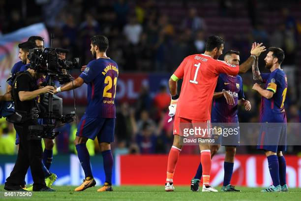 Gianluigi Buffon of Juventus and Lionel Messi of Barcelona embrace after the UEFA Champions League Group D match between FC Barcelona and Juventus at...