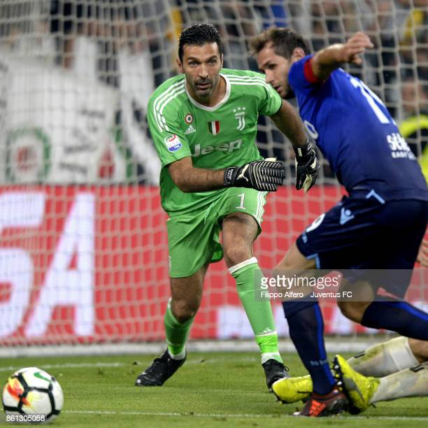 Gianluigi Buffon of Juventus and Senad Lulic of Lazio competes for the ball during the Serie A match between Juventus and SS Lazio on October 14 2017...