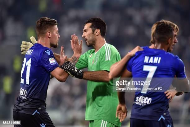 Gianluigi Buffon of Juventus and Sergej MilinkovicSavic during the Serie A match between Juventus and SS Lazio on October 14 2017 in Turin Italy