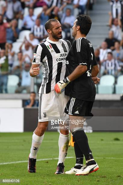 Gianluigi Buffon of Juventus celebrate with Giorgio Chiellini after saving the penalty during the Serie A match between Juventus and Cagliari Calcio...