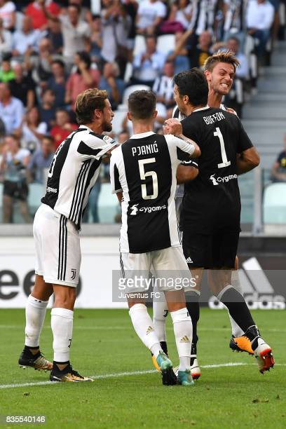 Gianluigi Buffon of Juventus celebrate with team mate after saving the penalty during the Serie A match between Juventus and Cagliari Calcio at...