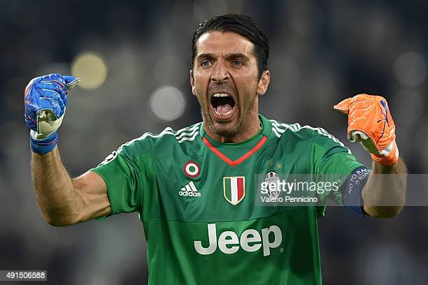 Gianluigi Buffon of Juventus celebrates after his teammate Alvaro Morata scored the opening goal during the UEFA Champions League group E match...