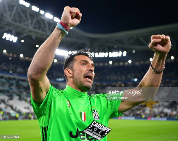 Gianluigi Buffon of Juventus celebrates as a flyer for the Cardiff final flys infront of him after the UEFA Champions League Semi Final second leg...