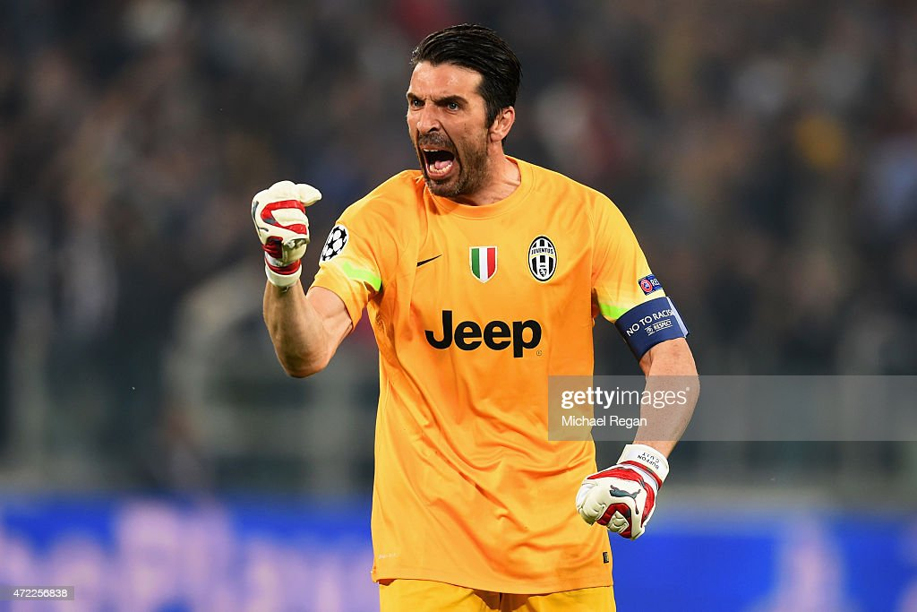 <a gi-track='captionPersonalityLinkClicked' href=/galleries/search?phrase=Gianluigi+Buffon&family=editorial&specificpeople=208860 ng-click='$event.stopPropagation()'>Gianluigi Buffon</a> of Juventus celebrates as Alvaro Morata of Juventus scores their first goal during the UEFA Champions League semi final first leg match between Juventus and Real Madrid CF at Juventus Arena on May 5, 2015 in Turin, Italy.