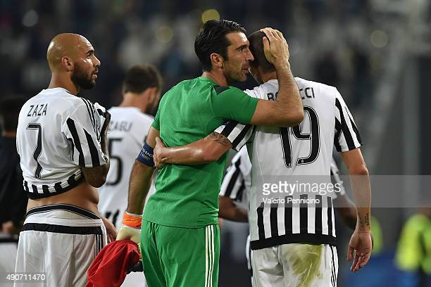 Gianluigi Buffon of Juventus celebrates victory with his teammate Leonardo Bonucci at the end of the UEFA Champions League group E match between...