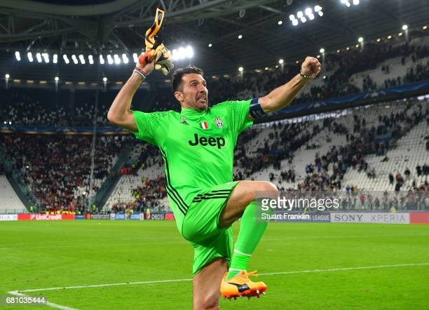 Gianluigi Buffon of Juventus celebrates with fans after the full time whistle following victory in the UEFA Champions League Semi Final second leg...