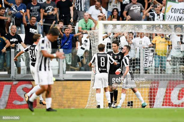 Gianluigi Buffon of Juventus celebrates with team mates after saving the penalty during the Serie A match between Juventus and Cagliari Calcio at...
