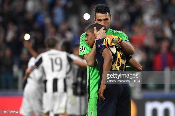 Gianluigi Buffon of Juventus consoles Kylian Mbappe of AS Monaco at the end of the UEFA Champions League Semi Final second leg match between Juventus...