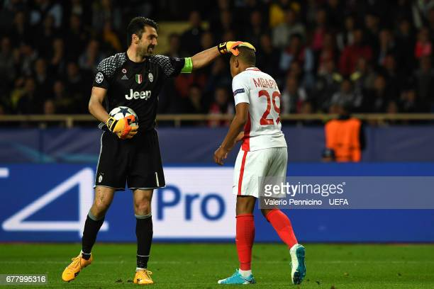 Gianluigi Buffon of Juventus consoles Kylian Mbappe of AS Monaco during the UEFA Champions League Semi Final first leg match between AS Monaco v...