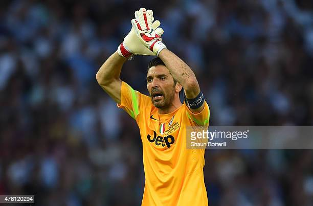 Gianluigi Buffon of Juventus encourages his team during the UEFA Champions League Final between Juventus and FC Barcelona at Olympiastadion on June 6...
