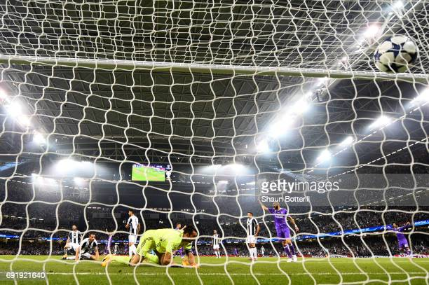 Gianluigi Buffon of Juventus fails to save Cristiano Ronaldo of Real Madrid shot for Real Madrid first goal during the UEFA Champions League Final...
