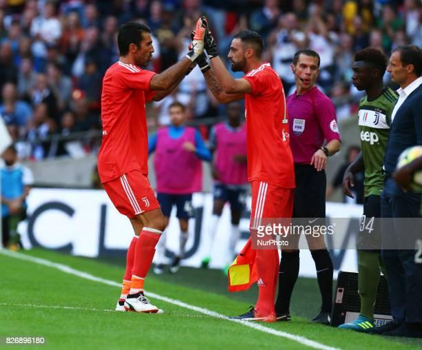 LR Gianluigi Buffon of Juventus FC and Carlo Pinsoglio of Juventus FC during the Friendly match between Tottenham Hotspur and Juventus at Wembley...
