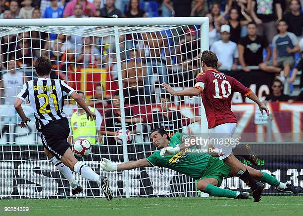 Gianluigi Buffon of Juventus FC and Francesco Totti AS Roma in action during the serie A match between AS Roma and Juventus FC at Stadio Olimpico on...