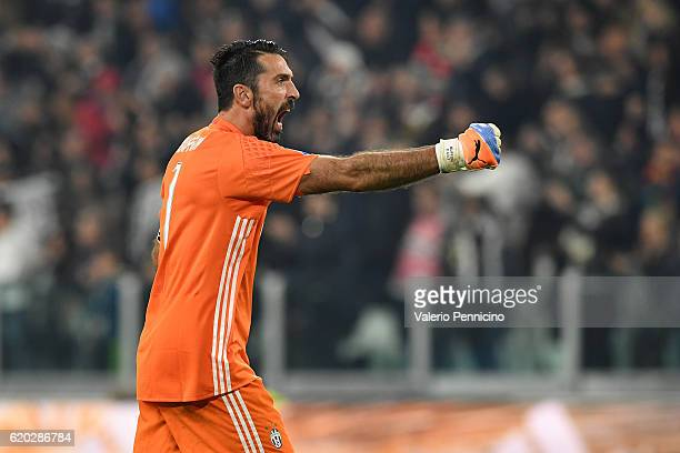 Gianluigi Buffon of Juventus FC celebrates after his team mate Gonzalo Higuain scored a goal during the Serie A match between Juventus FC and SSC...