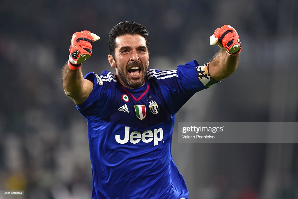 <a gi-track='captionPersonalityLinkClicked' href=/galleries/search?phrase=Gianluigi+Buffon&family=editorial&specificpeople=208860 ng-click='$event.stopPropagation()'>Gianluigi Buffon</a> of Juventus FC celebrates after his team-mate Juan Cuadrado scored the victory goal during the Serie A match between Juventus FC and Torino FC at Juventus Arena on October 31, 2015 in Turin, Italy.
