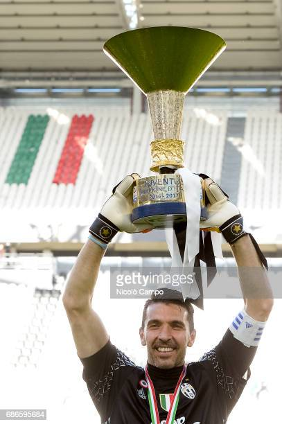 Gianluigi Buffon of Juventus FC celebrates the victory of the Italian Serie A 'Scudetto' at the end of the Serie A football match between Juventus FC...