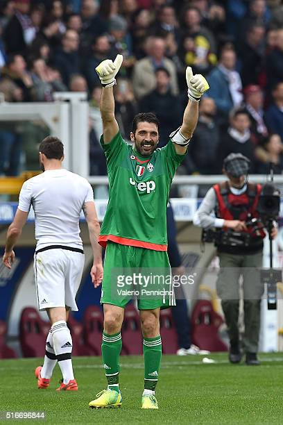 Gianluigi Buffon of Juventus FC celebrates victory and his record of minutes without conceding goals at the end of the Serie A match between Torino...