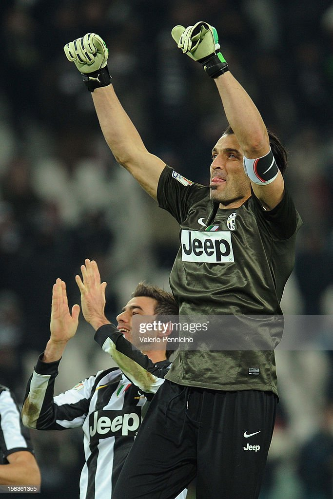 <a gi-track='captionPersonalityLinkClicked' href=/galleries/search?phrase=Gianluigi+Buffon&family=editorial&specificpeople=208860 ng-click='$event.stopPropagation()'>Gianluigi Buffon</a> of Juventus FC celebrates victory at the end of the TIM Cup match between Juventus FC and Cagliari Calcio at Juventus Arena on December 12, 2012 in Turin, Italy.
