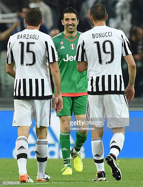Gianluigi Buffon of Juventus FC celebrates victory with team mates Andrea Barzagli and Leonardo Bonucci at the end of the Serie A match between...