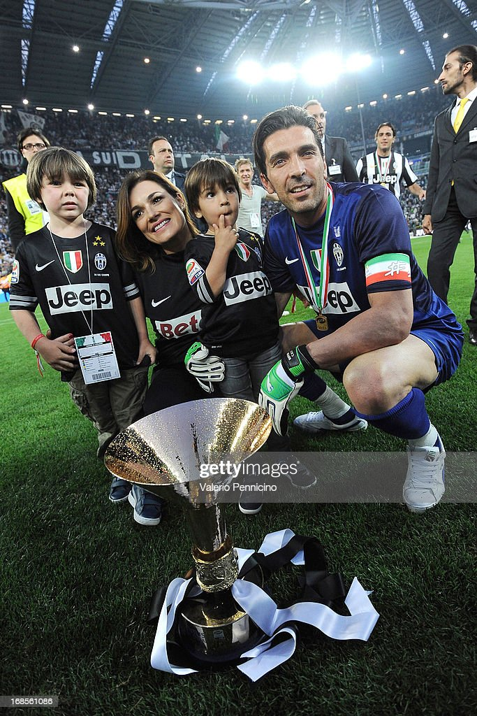 Gianluigi Buffon of Juventus FC celebrates with the Serie A trophy at the end of the Serie A match between Juventus and Cagliari Calcio at Juventus...