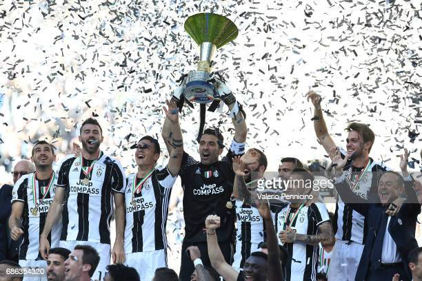 Gianluigi Buffon of Juventus FC celebrates with the trophy after the beating FC Crotone 30 to win the Serie A Championships at the end of the Serie A...
