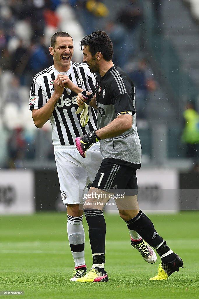 Gianluigi Buffon (R) of Juventus FC congratulates Leonardo Bonucci during the Serie A match between Juventus FC and Carpi FC at Juventus Arena on May 1, 2016 in Turin, Italy.