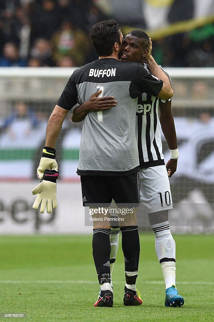 Gianluigi Buffon (L) of Juventus FC congratulates Paul Pogba during the Serie A match between Juventus FC and Carpi FC at Juventus Arena on May 1, 2016 in Turin, Italy.