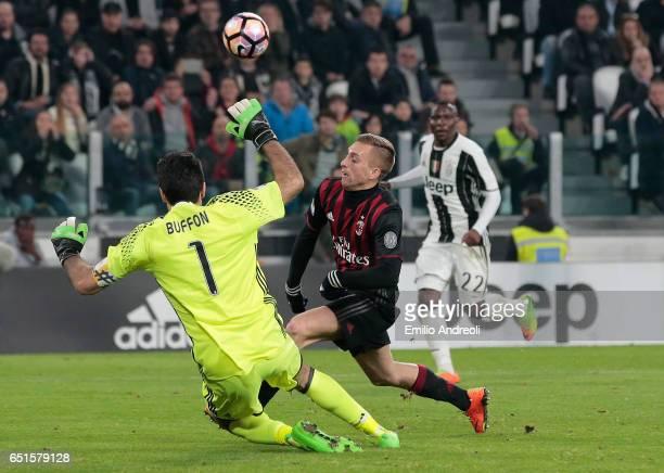 Gianluigi Buffon of Juventus FC dives to save a shot kicked by Gerard Deulofeu of AC Milan during the Serie A match between Juventus FC and AC Milan...