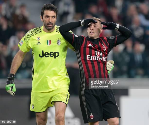 Gianluigi Buffon of Juventus FC embraces Gerard Deulofeu of AC Milan during the Serie A match between Juventus FC and AC Milan at Juventus Stadium on...