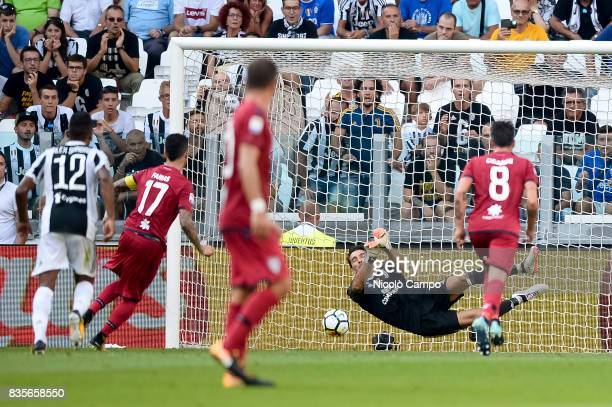 Gianluigi Buffon of Juventus FC saves a penalty of Diego Farias of Cagliari Calcio during the Serie A football match between Juventus FC and Cagliari...