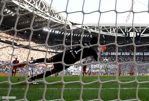 Gianluigi Buffon of Juventus FC saves a penalty shot during the Serie A match between Juventus and Cagliari Calcio at Allianz Stadium on August 19...