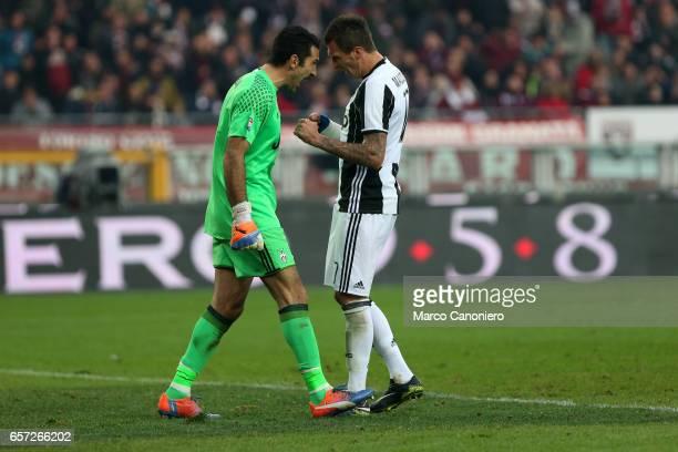 Gianluigi Buffon of Juventus Fc with his teammate Mario Mandzukic during the Serie A football match between Torino FC and Juventus FC Juventus FC won...