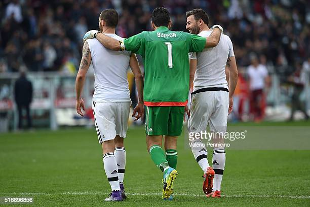 Gianluigi Buffon of Juventus FC with team mates Leonardo Bonucci and Andrea Barzagli celebrate victory and his record of minutes without conceding...