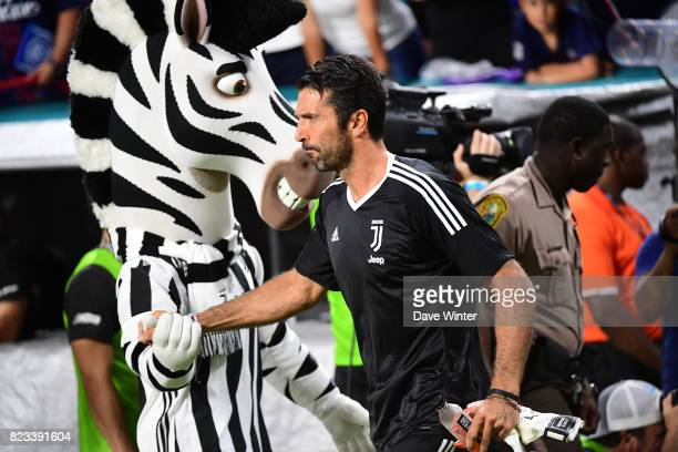 Gianluigi Buffon of Juventus greets the team mascot before the International Champions Cup match between Paris Saint Germain and Juventus Turin at...